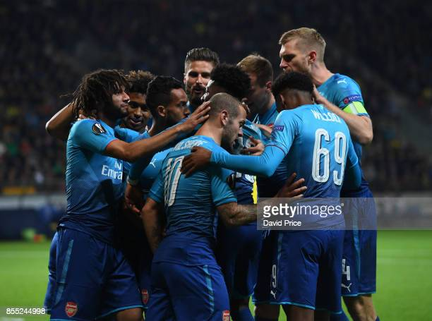 Jack Wilshere celebrates the 1st Arsenal goal with his team mates during the UEFA Europa League group H match between BATE Borisov and Arsenal FC at...