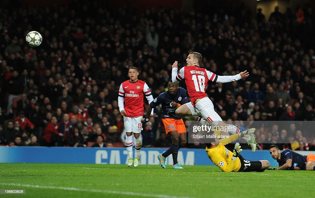 Jack Wilshere chips the ball over Montpellier goalkeeper Geoffrey Jourden to score the 1st Arsenal goal during the UEFA Champions League Group B match between Arsenal FC and Montpellier Herault SC at Emirates Stadium on November 21, 2012 in London, England.