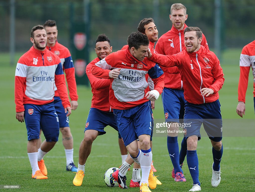 Jack Wilshere Francis Coquelin Laurent Koscielny and Aaron Ramsey of Arsenal during a training session at London Colney on April 3 2015 in St Albans...