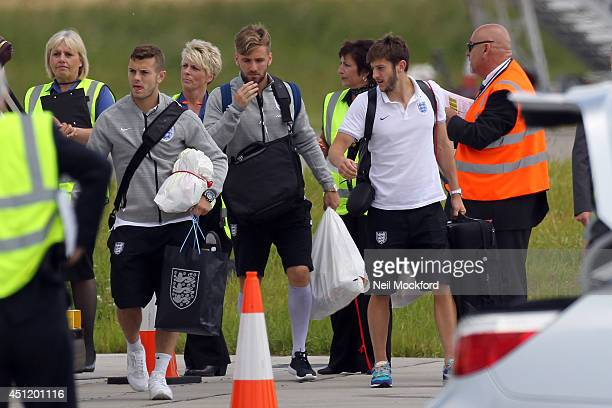 Jack Wilshere Luke Shaw and Adam Lallana seen arriving home at Luton Airport on June 25 2014 in Luton England
