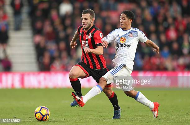 Jack Wilshere of AFC Bournemouth and Steven Pienaar of Sunderland battle for possession during the Premier League match between AFC Bournemouth and...