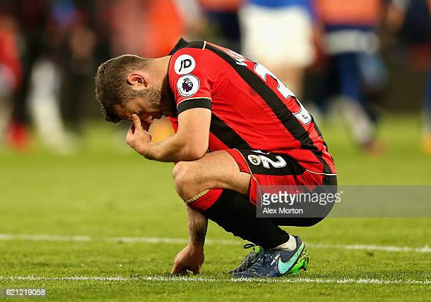 Jack Wilshere of AFC Bournemouth is defected after the final whistle during the Premier League match between AFC Bournemouth and Sunderland at...