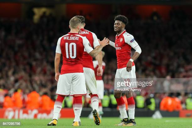 Jack Wilshere of Arsenal Ainsley MaitlandNiles of Arsenal celebrate the win during the UEFA Europa League group H match between Arsenal FC and Koln...