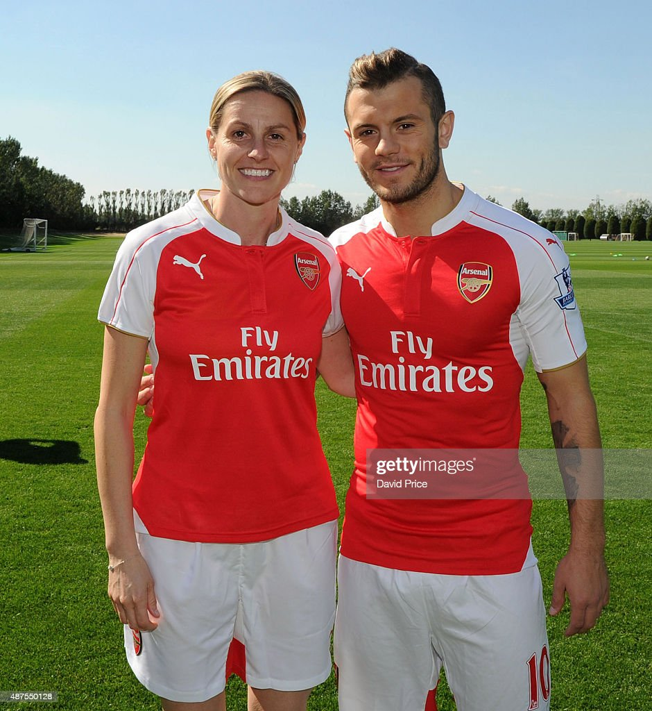 Jack Wilshere of Arsenal and Kelly Smith of Arsenal Ladies after the Arsenal 1st Team Group Photograph at London Colney on September 10, 2015 in St Albans, England.