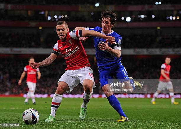 Jack Wilshere of Arsenal and Leighton Baines of Everton battle for the ball during the Barclays Premier League match between Arsenal and Everton at...