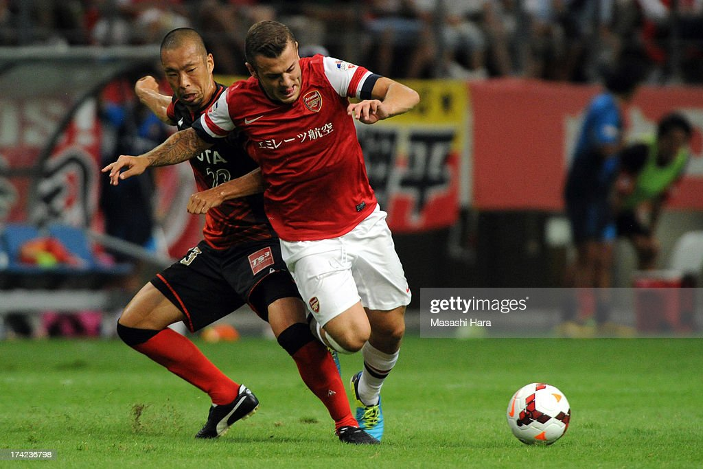 <a gi-track='captionPersonalityLinkClicked' href=/galleries/search?phrase=Jack+Wilshere&family=editorial&specificpeople=5446655 ng-click='$event.stopPropagation()'>Jack Wilshere</a> #10 of Arsenal (R) and Yosuke Ishibitsu #23 of Nagoya Grampus compete for the ball during the pre-season friendly match between Nagoya Grampus and Arsenal at Toyota Stadium on July 22, 2013 in Toyota, Aichi, Japan.