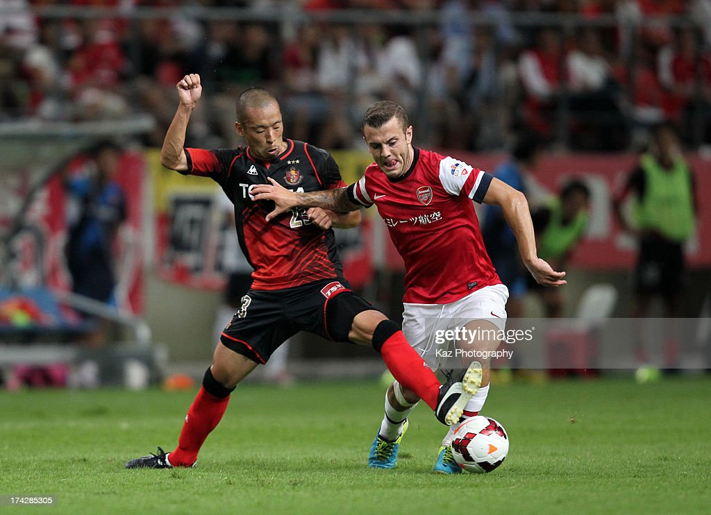 <a gi-track='captionPersonalityLinkClicked' href=/galleries/search?phrase=Jack+Wilshere&family=editorial&specificpeople=5446655 ng-click='$event.stopPropagation()'>Jack Wilshere</a> of Arsenal and Yosuke Ishibitsu of Nagoya Grampus compete for the ball during the pre-season friendly match between Nagoya Grampus and Arsenal at Toyota Stadium on July 22, 2013 in Toyota, Aichi, Japan.