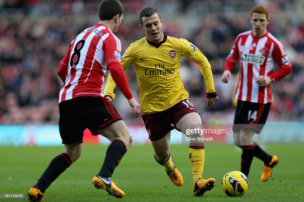 Jack Wilshere of Arsenal attempts to move past Craig Gardner of Sunderland during the Barclays Premier League match between Sunderland and Arsenal at the Stadium of Light on February 9, 2013 in Sunderland, England.