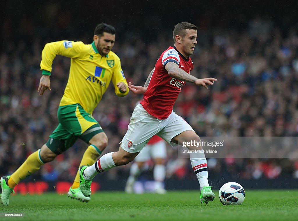 <a gi-track='captionPersonalityLinkClicked' href=/galleries/search?phrase=Jack+Wilshere&family=editorial&specificpeople=5446655 ng-click='$event.stopPropagation()'>Jack Wilshere</a> of Arsenal breaks past Bradley Johnson of Norwich during the Barclays Premier League match between Arsenal and Norwich City at Emirates Stadium on April 13, 2013 in London, England.