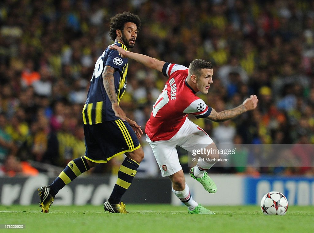 <a gi-track='captionPersonalityLinkClicked' href=/galleries/search?phrase=Jack+Wilshere&family=editorial&specificpeople=5446655 ng-click='$event.stopPropagation()'>Jack Wilshere</a> of Arsenal breaks past Christian of Fenerbahce during the UEFA Champions League Play Off Second leg match between Arsenal FC and Fenerbahce SK at Emirates Stadium on August 27, 2013 in London, England.