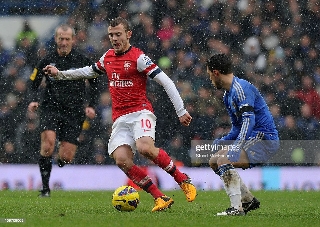 Jack Wilshere of Arsenal breaks past Eden Hazard of Chelsea during the Barclays Premier League match between Chelsea and Arsenal at Stamford Bridge on January 20, 2013 in London, England.