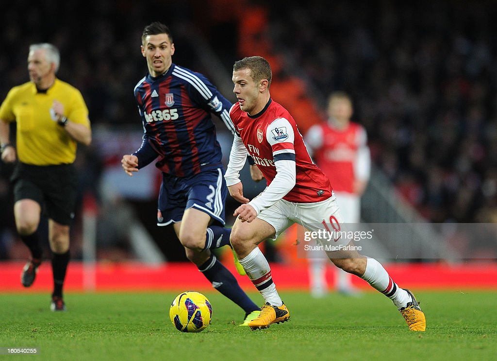 <a gi-track='captionPersonalityLinkClicked' href=/galleries/search?phrase=Jack+Wilshere&family=editorial&specificpeople=5446655 ng-click='$event.stopPropagation()'>Jack Wilshere</a> of Arsenal breaks past <a gi-track='captionPersonalityLinkClicked' href=/galleries/search?phrase=Geoff+Cameron&family=editorial&specificpeople=5101639 ng-click='$event.stopPropagation()'>Geoff Cameron</a> of Stoke during the Barclays Premier League match between Arsenal and Stoke City at Emirates Stadium on February 02, 2013 in London, England.