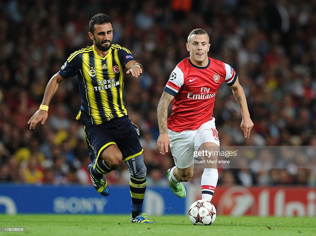 <a gi-track='captionPersonalityLinkClicked' href=/galleries/search?phrase=Jack+Wilshere&family=editorial&specificpeople=5446655 ng-click='$event.stopPropagation()'>Jack Wilshere</a> of Arsenal breaks past Gokhan Gonul of Fenerbahce during the UEFA Champions League Play Off Second leg match between Arsenal FC and Fenerbahce SK at Emirates Stadium on August 27, 2013 in London, England.