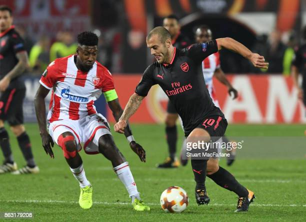Jack Wilshere of Arsenal breaks past Mitchell Donald of Red Star during the UEFA Europa League group H match between Crvena Zvezda and Arsenal FC at...