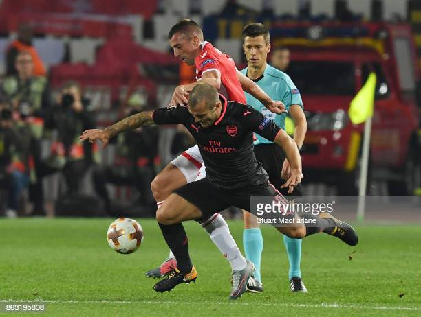 Jack Wilshere of Arsenal breaks past Nenad Krsticic of Red Star during the UEFA Europa League group H match between Crvena Zvezda and Arsenal FC at...