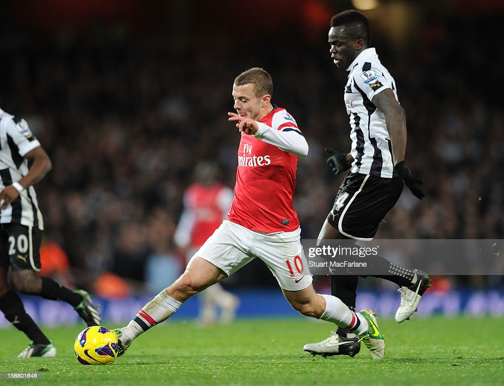 Jack Wilshere of Arsenal breaks past Newcastle's Chieck Tiote during the Barclays Premier League match between Arsenal and Newcastle United at Emirates Stadium on December 29, 2012 in London, England.