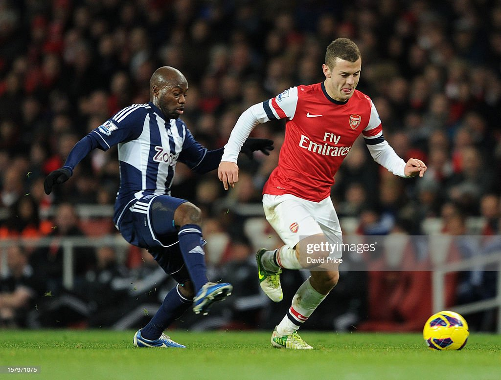 Jack Wilshere of Arsenal bursts away from Youssouf Mulumbu of WBA during the Barclays Premier League match between Arsenal and West Bromwich Albion, at Emirates Stadium on December 08, 2012 in London, England.