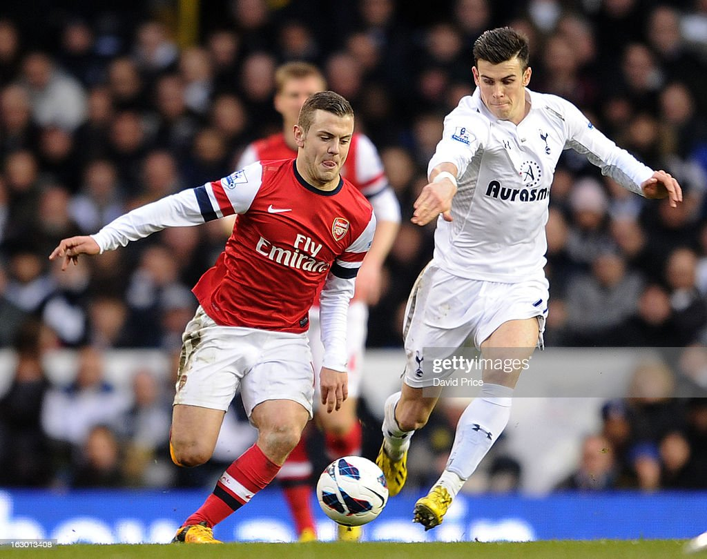 Jack Wilshere of Arsenal bursts past Gareth Bale of Tottenham during the Barclays Premier League match between Tottenham Hotspur and Arsenal at White Hart Lane on March 3, 2013 in London, England.