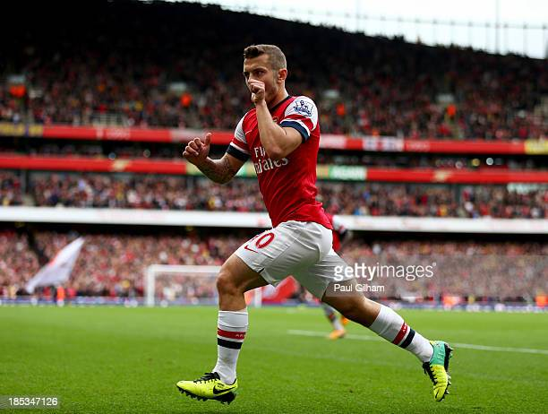 Jack Wilshere of Arsenal celebrates as he scores their first goal during the Barclays Premier League match between Arsenal and Norwich City at...