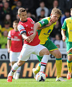 Jack WIlshere of Arsenal challenged by Michael Turner of Norwich during the Barclays Premier League match between Norwich City and Arsenal at Carrow...