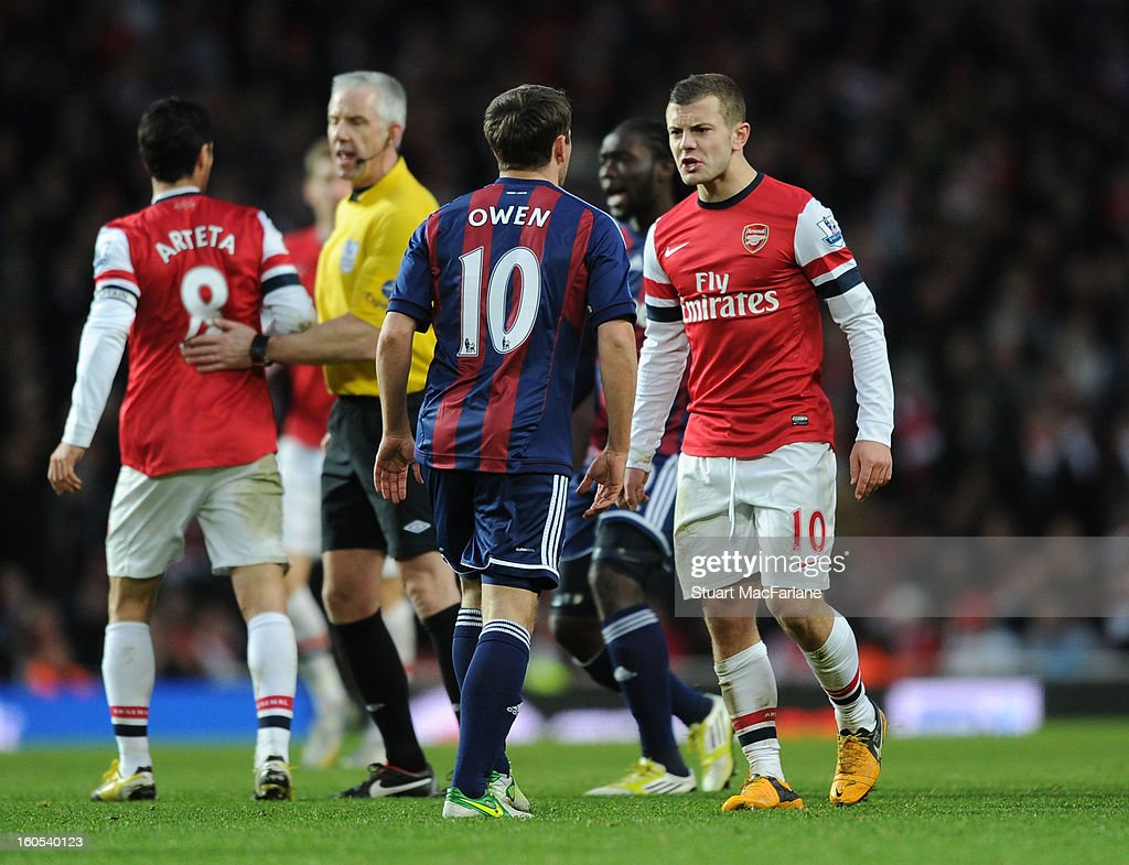 <a gi-track='captionPersonalityLinkClicked' href=/galleries/search?phrase=Jack+Wilshere&family=editorial&specificpeople=5446655 ng-click='$event.stopPropagation()'>Jack Wilshere</a> of Arsenal clashes with Michael Owen of Stoke during the Barclays Premier League match between Arsenal and Stoke City at Emirates Stadium on February 02, 2013 in London, England.