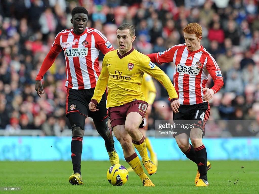 Jack Wilshere of Arsenal drives past Alfred N'Diaye and Jack Colback of Sunderland during the Barclays Premier League match between Sunderland and Arsenal at Stadium of Light on February 09, 2013 in Sunderland, England.