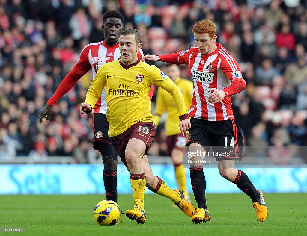 <a gi-track='captionPersonalityLinkClicked' href=/galleries/search?phrase=Jack+Wilshere&family=editorial&specificpeople=5446655 ng-click='$event.stopPropagation()'>Jack Wilshere</a> of Arsenal drives past <a gi-track='captionPersonalityLinkClicked' href=/galleries/search?phrase=Alfred+N%27Diaye&family=editorial&specificpeople=5553791 ng-click='$event.stopPropagation()'>Alfred N'Diaye</a> and <a gi-track='captionPersonalityLinkClicked' href=/galleries/search?phrase=Jack+Colback&family=editorial&specificpeople=4940395 ng-click='$event.stopPropagation()'>Jack Colback</a> of Sunderland during the Barclays Premier League match between Sunderland and Arsenal at Stadium of Light on February 09, 2013 in Sunderland, England.