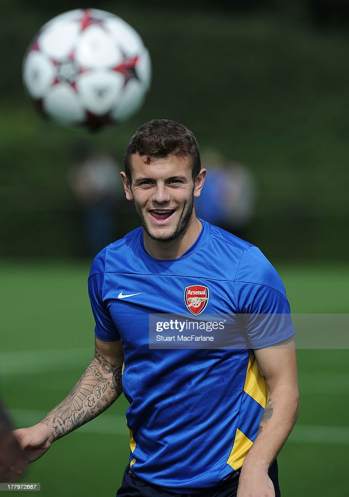 Jack Wilshere of Arsenal during a training session ahead of their UEFA Champions League Play Off second leg match against Fenerbache at London Colney on August 26, 2013 in St Albans, England.