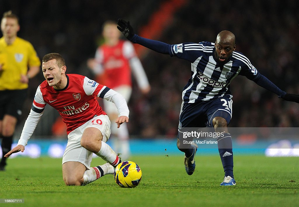 <a gi-track='captionPersonalityLinkClicked' href=/galleries/search?phrase=Jack+Wilshere&family=editorial&specificpeople=5446655 ng-click='$event.stopPropagation()'>Jack Wilshere</a> of Arsenal fouled by Youssouf Mulumbu during the Barclays Premier League match between Arsenal and West Bromwich Albion, at Emirates Stadium on December 08, 2012 in London, England.