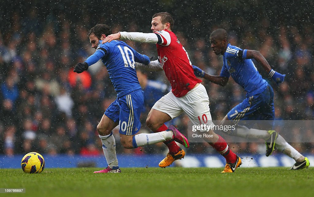 Jack Wilshere of Arsenal grabs Juan Mata of Chelsea during the Barclays Premier League match between Chelsea and Arsenal at Stamford Bridge on January 20, 2013 in London, England.