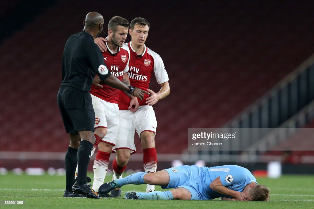 Jack Wilshere of Arsenal headbuts Matthew Smith of Manchester City and is later sent off during the Premier League 2 match between Arsenal v Manchester City at Emirates Stadium on August 21, 2017 in London, England.