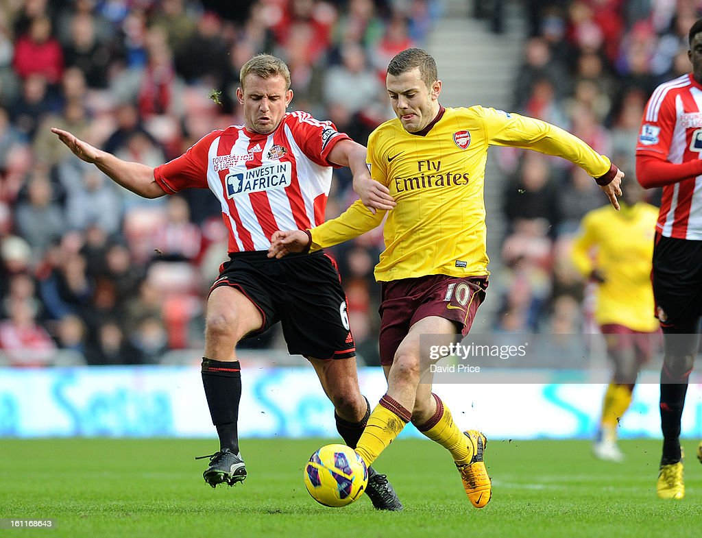 <a gi-track='captionPersonalityLinkClicked' href=/galleries/search?phrase=Jack+Wilshere&family=editorial&specificpeople=5446655 ng-click='$event.stopPropagation()'>Jack Wilshere</a> of Arsenal holds off Lee Catermole of Sunderland during the Barclays Premier League match between Sunderland and Arsenal at Stadium of Light on February 09, 2013 in Sunderland, England.