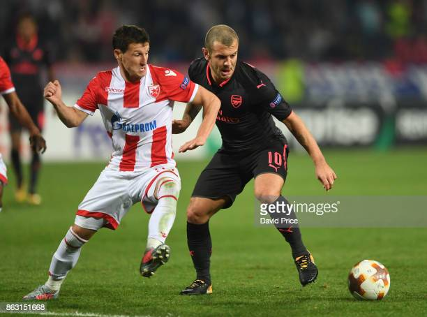 Jack Wilshere of Arsenal holds off Slavoljub Smic of Red Star during the UEFA Europa League group H match between Crvena Zvezda and Arsenal FC at...