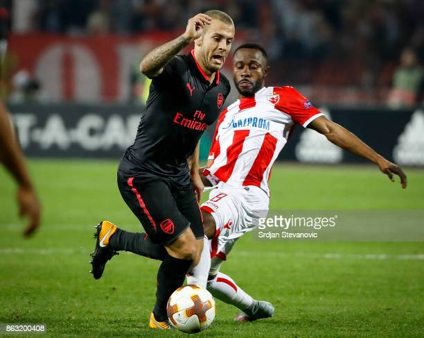 Jack Wilshere of Arsenal in action against Guelor Kanga of Crvena Zvezda during the UEFA Europa League group H match between Crvena Zvezda and...