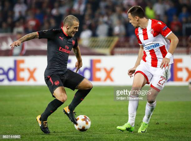 Jack Wilshere of Arsenal in action against Milan Rodic of Crvena Zvezda during the UEFA Europa League group H match between Crvena Zvezda and Arsenal...