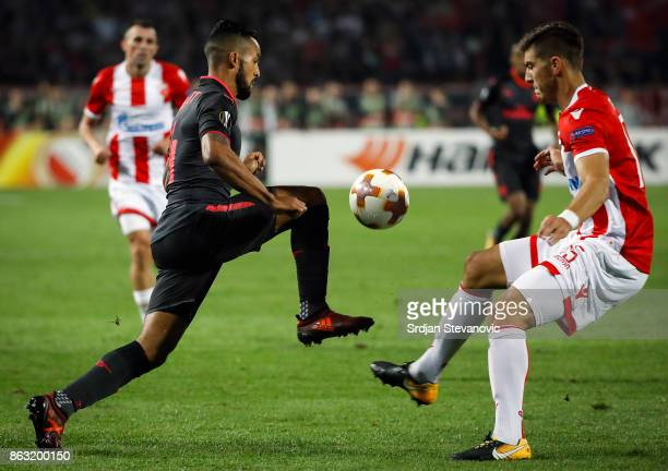 Jack Wilshere of Arsenal in action against Srdjan Babic of Crvena Zvezda during the UEFA Europa League group H match between Crvena Zvezda and...