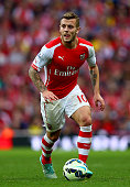 Jack Wilshere of Arsenal in action during the Barclays Premier League match between Arsenal and Hull City at Emirates Stadium on October 18 2014 in...