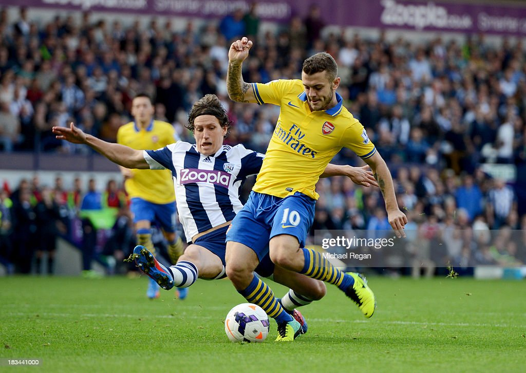 <a gi-track='captionPersonalityLinkClicked' href=/galleries/search?phrase=Jack+Wilshere&family=editorial&specificpeople=5446655 ng-click='$event.stopPropagation()'>Jack Wilshere</a> of Arsenal is challenged by Billy Jones of West Bromwich Albion during the Barclays Premier League match between West Bromwich Albion and Arsenal at The Hawthorns on October 6, 2013 in West Bromwich, England.
