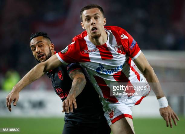 Jack Wilshere of Arsenal is challenged by Milan Rodic of Crvena Zvezda during the UEFA Europa League group H match between Crvena Zvezda and Arsenal...