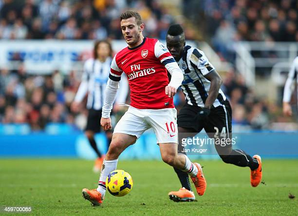 Jack Wilshere of Arsenal is closed down by Cheick Tiote of Newcastle United during the Barclays Premier League match between Newcastle United and...