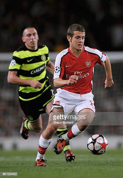 Jack Wilshere of Arsenal is pursued by Scott Brown of Celtic during the UEFA Champions League 2nd qualifying round 2nd leg match between Arsenal and...