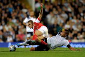 Jack Wilshere of Arsenal is tackled by Jake Livermore of Spurs during the Carling Cup third round match between Tottenham Hotspur and Arsenal at...