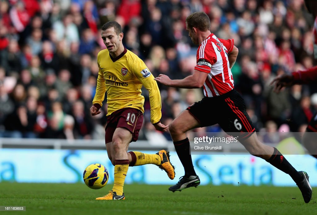 Jack Wilshere of Arsenal moves away from Lee Cattermole of Sunderland during the Barclays Premier League match between Sunderland and Arsenal at the Stadium of Light on February 9, 2013 in Sunderland, England.