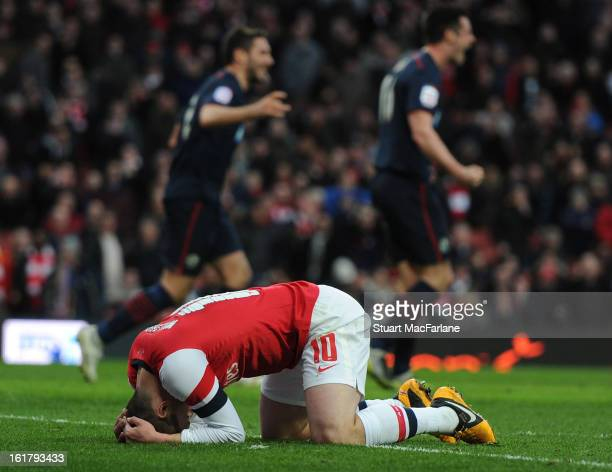 Jack Wilshere of Arsenal reacts as Blackburn players celebrate scoring the only goal of the game during the FA Cup Fifth Round match between Arsenal...