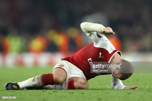 Jack Wilshere of Arsenal reacts to going down injured during the UEFA Europa League group H match between Arsenal FC and Crvena Zvezda at Emirates...