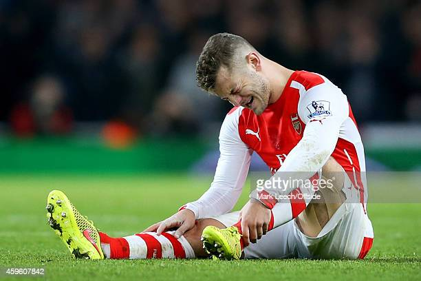 Jack Wilshere of Arsenal reacts to injuring his ankle during the Barclays Premier League match between Arsenal and Manchester United at Emirates...
