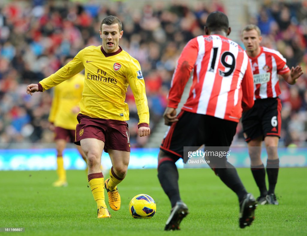 Jack WIlshere of Arsenal runs at Titus Bramble of Sunderland during the Barclays Premier League match between Sunderland and Arsenal at Stadium of Light on February 09, 2013 in Sunderland, England.