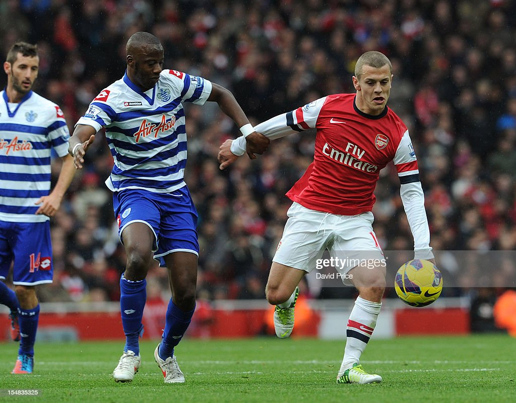 <a gi-track='captionPersonalityLinkClicked' href=/galleries/search?phrase=Jack+Wilshere&family=editorial&specificpeople=5446655 ng-click='$event.stopPropagation()'>Jack Wilshere</a> of Arsenal Samba Diakite of QPR during the Barclays Premier League match between Arsenal and Queens Park Rangers, at Emirates Stadium on SOctober 27, 2012 in London, England.