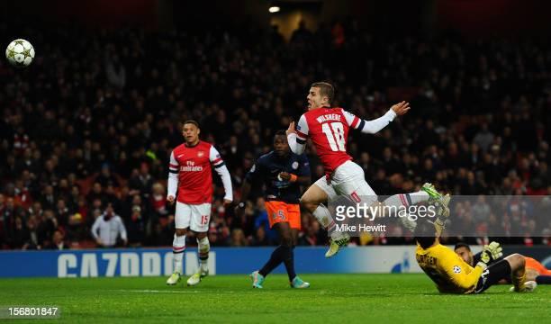 Jack Wilshere of Arsenal scores the opening goal during the UEFA Champions League group B match between Arsenal FC and Montpellier Herault SC at...