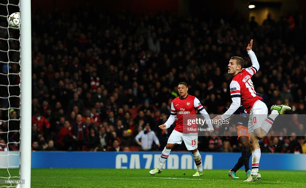 <a gi-track='captionPersonalityLinkClicked' href=/galleries/search?phrase=Jack+Wilshere&family=editorial&specificpeople=5446655 ng-click='$event.stopPropagation()'>Jack Wilshere</a> of Arsenal scores the opening goal during the UEFA Champions League group B match between Arsenal FC and Montpellier Herault SC at Emirates Stadium on November 21, 2012 in London, England.